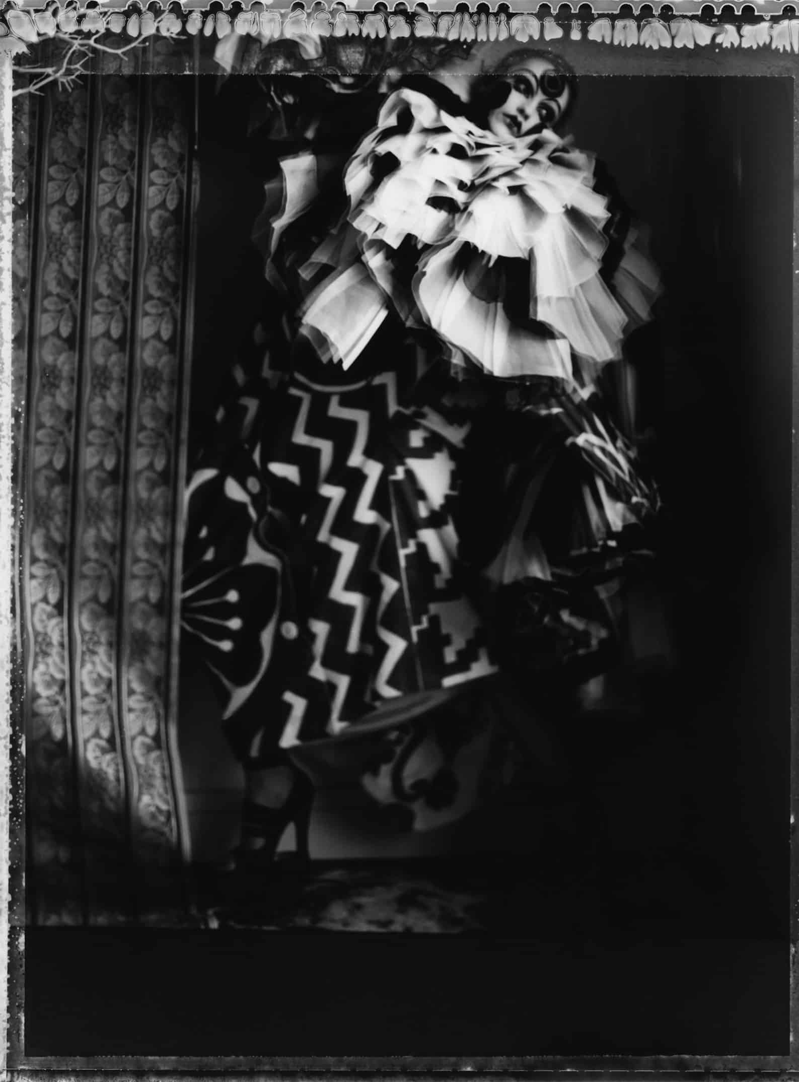 Fine art b/w photography of a fashion model wearing haute couture by DIOR by John Galliano.