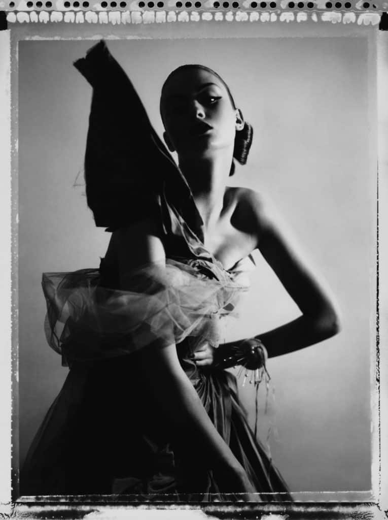 Fine art b/w photography of a fashion model wearing haute couture DIOR by John Galliano.