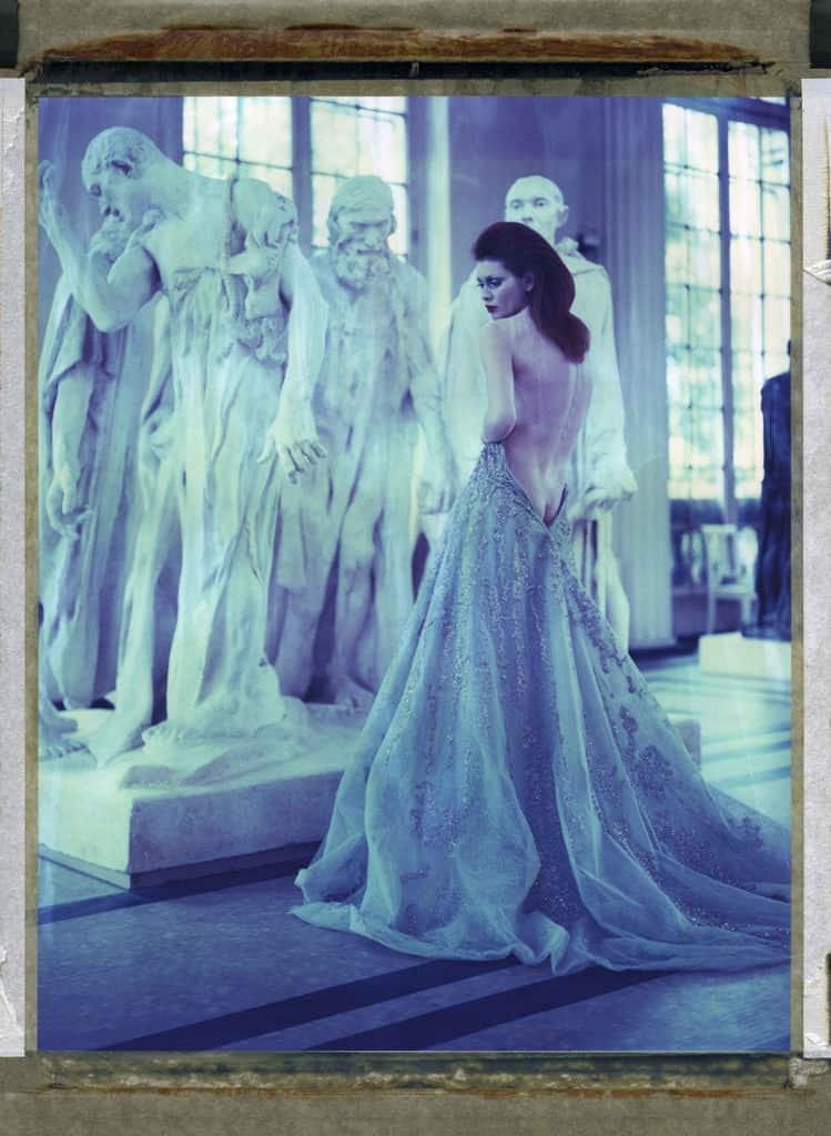 "Fine art color photography of semin-nude fashion model wearing Haute Couture by Elie Saab, photographed in front of August Rodin's sculpture ""Les Bourgeois de Calais"" at the Musée Rodin Meudon, France"