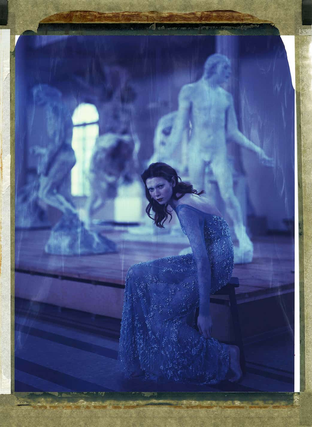 Fine art color photography of fashion model wearing Haute Couture by Elie Saab, photographed in front of sculptures by Auguste Rodin at the Musée Rodin Meudon, France.