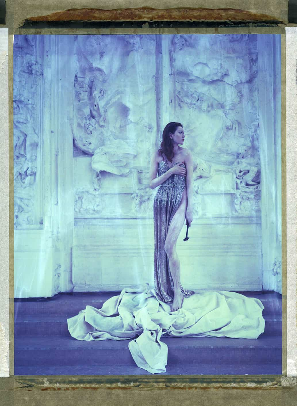"""Fine Art color photography with fashion model wearing Haute Couture by Elie Saab, photographed in front of August Rodin's art work """"The Gates of Hell"""" at the Musée Rodin Meudon. The photograph is an hommage to Edward Steichen."""