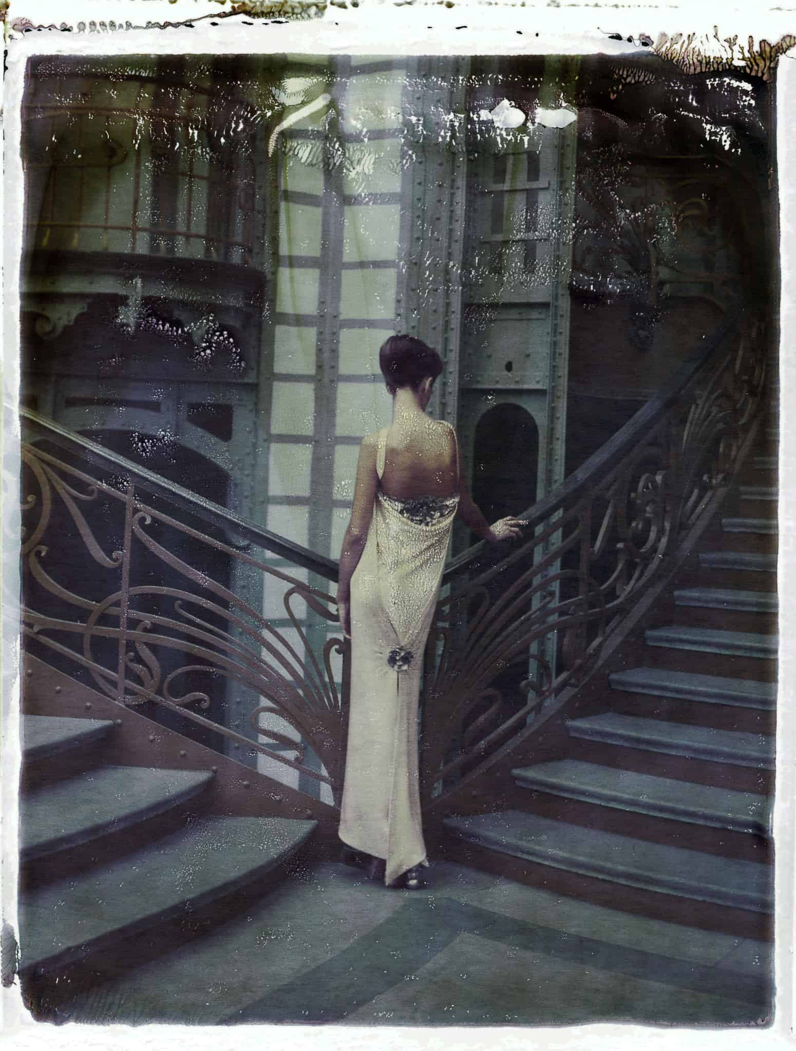 Fine art color photography of fashion model wearing haute couture CHANEL by Karl Lagerfeld, at the Grand Palais, Paris.