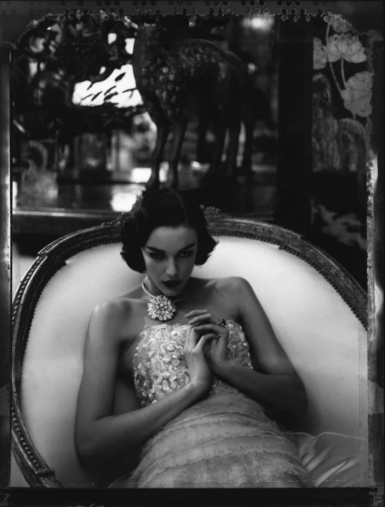 Fine art b/w photography of a fashion model wearing haute couture CHANEL by Karl Lagerfeld and haute jewellery CHANEL, photographed at the apartment of Coco Chanel, rue Cambon.