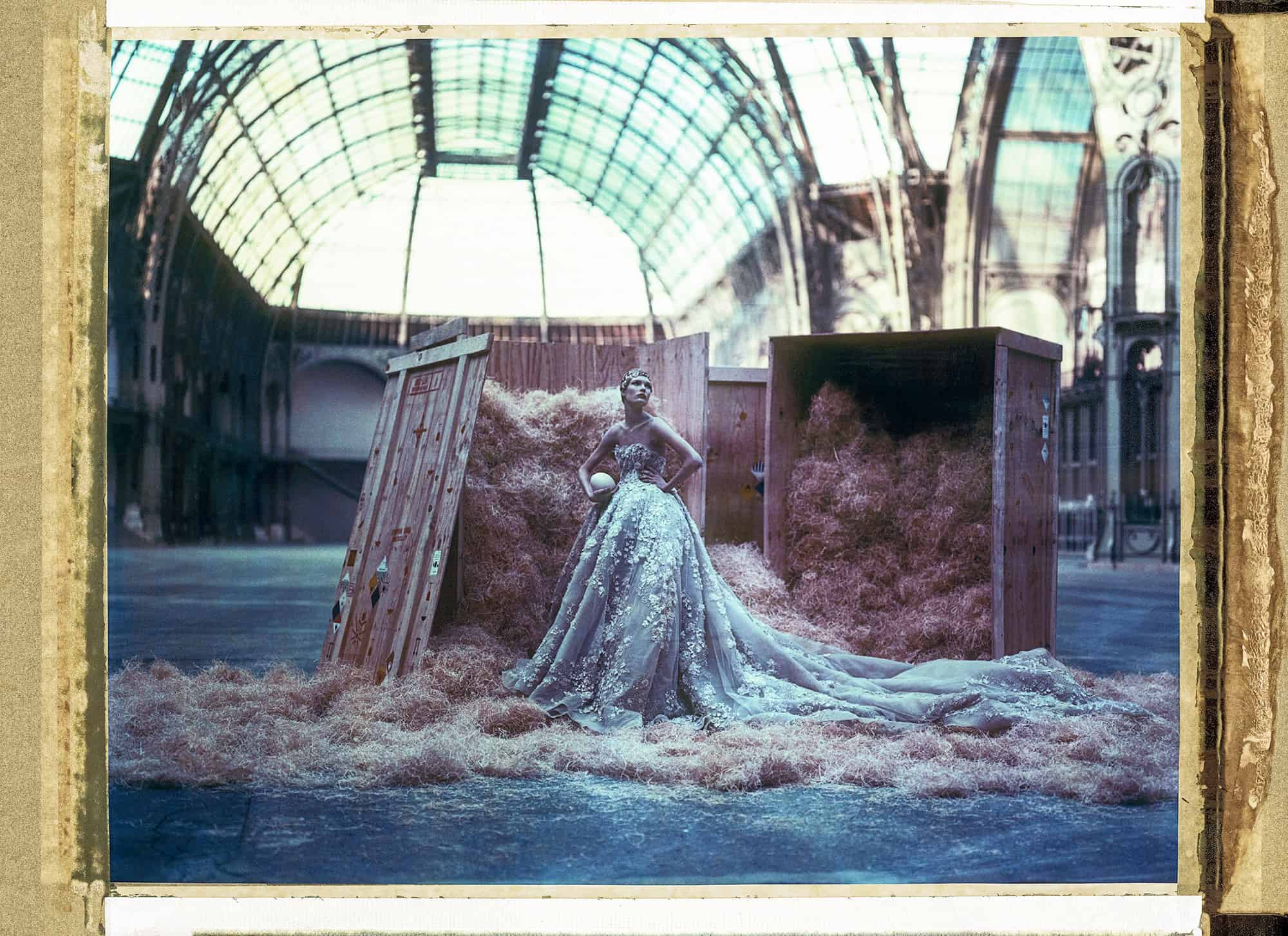 Fine art color photography of a fashion model wearing haute couture by Elie Saab with ostrich egg, at the Grand Palais, Paris.