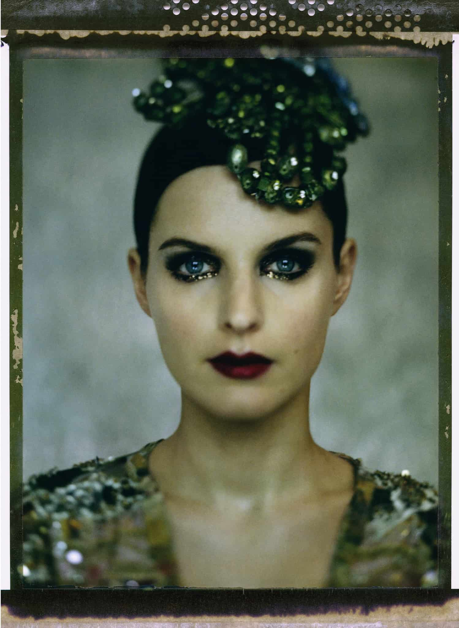 Fine art color photography of a fashion model wearing haute couture and fantasy jewellery by Christian Lacroix.
