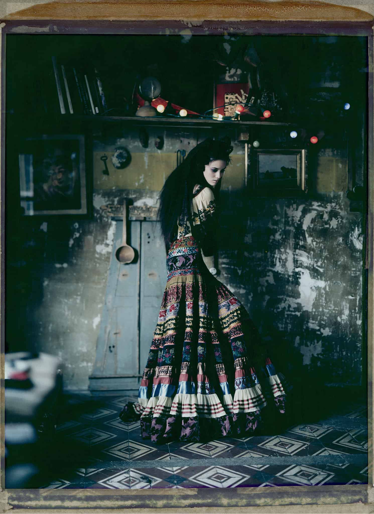 Fine art color photography of a fashion model wearing haute couture by Jean Paul Gaultier. Photographed at a painter's studio, Montmartre, Paris.