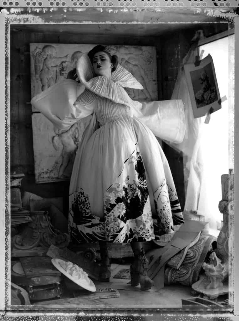 Fine art b/w photography of a fashion model wearing haute couture DIOR by John Galliano, Japanese Collection. Photographed at Atelier de Stile, plaster cast room, Paris, France.