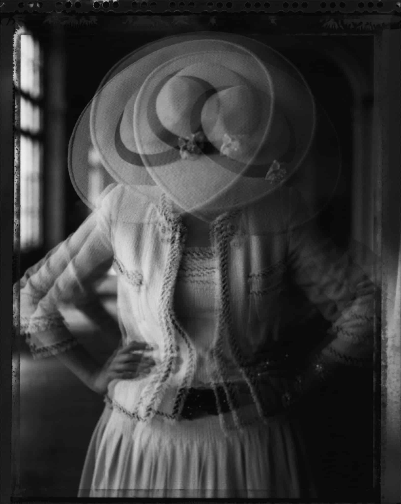 Fine art b/w photography of a fashion model wearing haute couture CHANEL by Karl Lagerfeld, photographed at Theatre de Trianon, Montmartre, Paris.