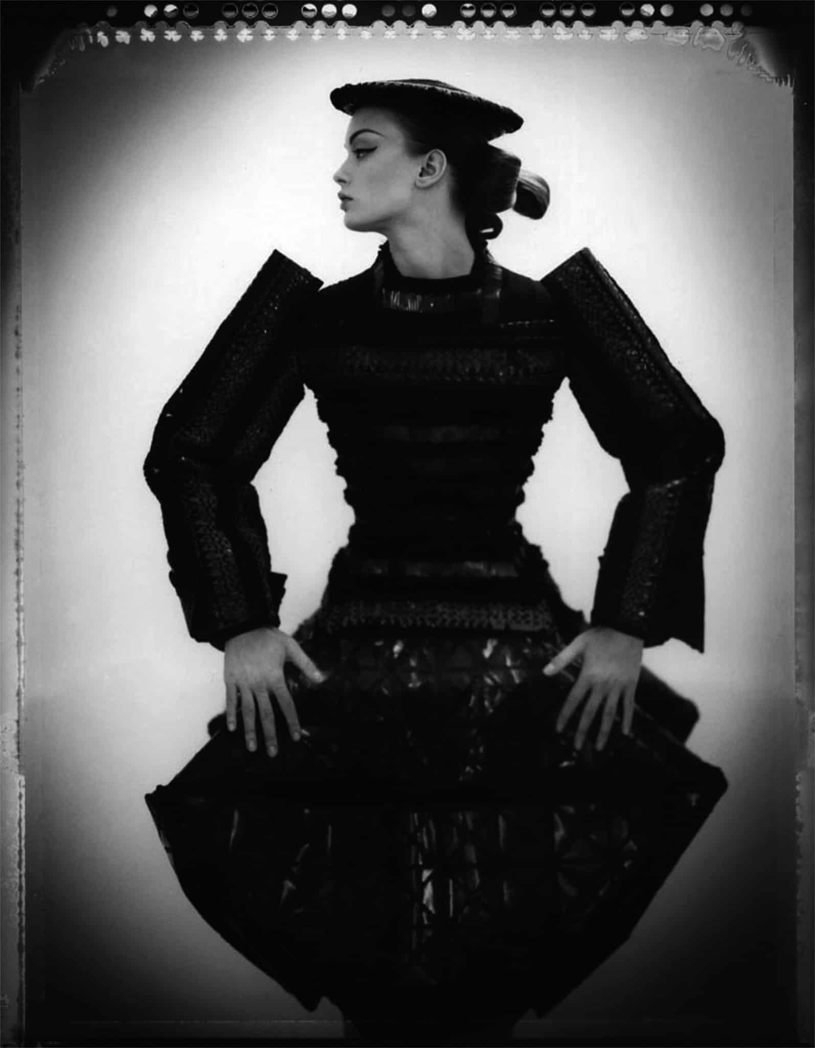 Fine art b/w photography of a fashion model wearing haute couture DIOR by John Galliano, Japanese Collection, hat by Steven Stones.