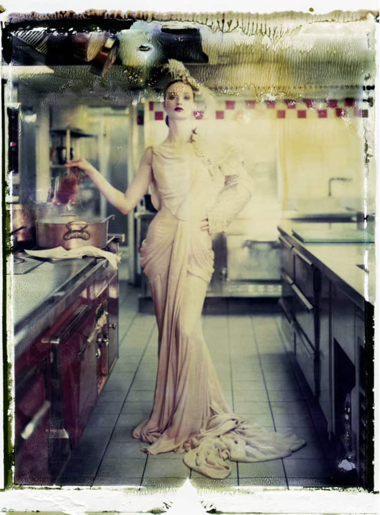 Fine art color photography of a fashion model wearing haute couture DIOR by John Galliano. Photographed at the kitchen of the Hotel Plaza Athénée, Paris.