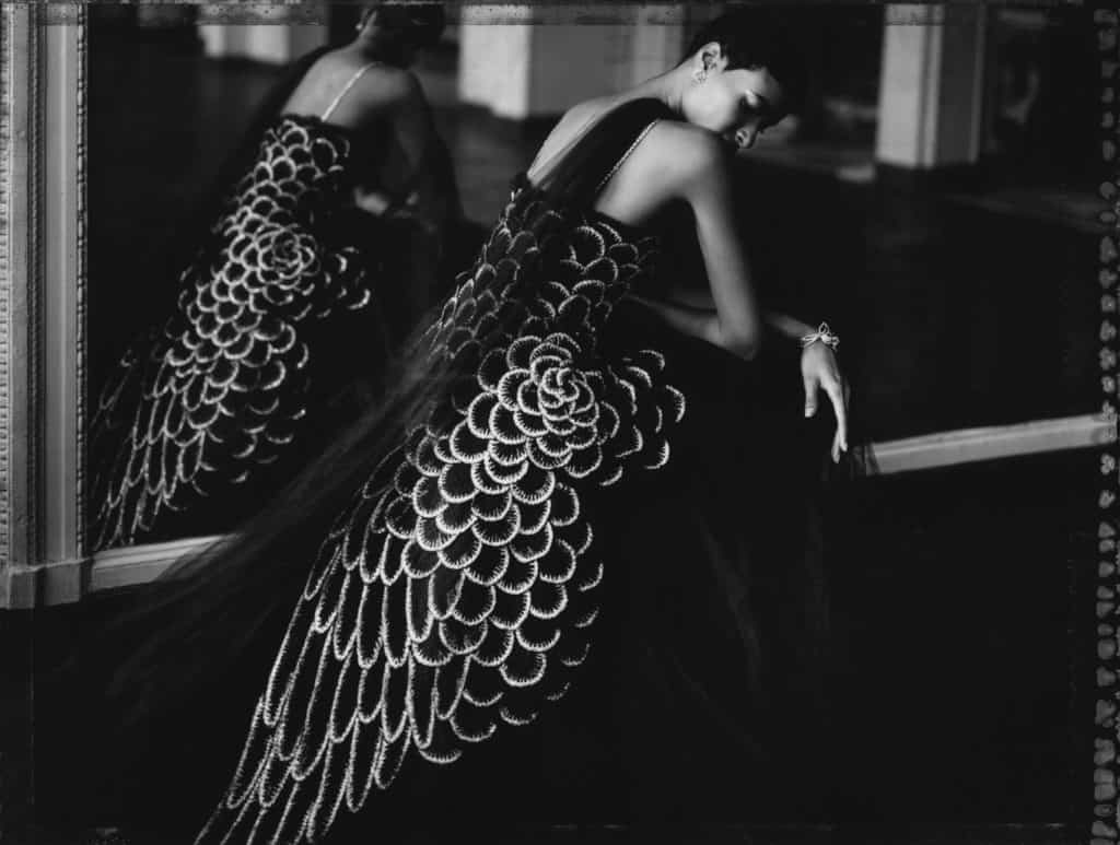 Fine art b/w photography of a black fashion model wearing haute couture CHANEL by Karl Lagerfeld. Photographed at Theatre de Trianon, Montmartre, Paris.