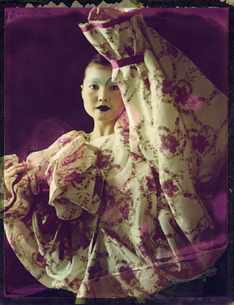 Fine art color photography of a fashion model wearing haute couture by John Galliano.