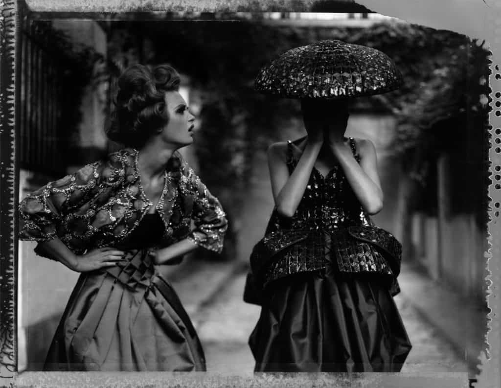 Fine art b/w photography of two fashion models women in haute couture by DIOR John Galliano.
