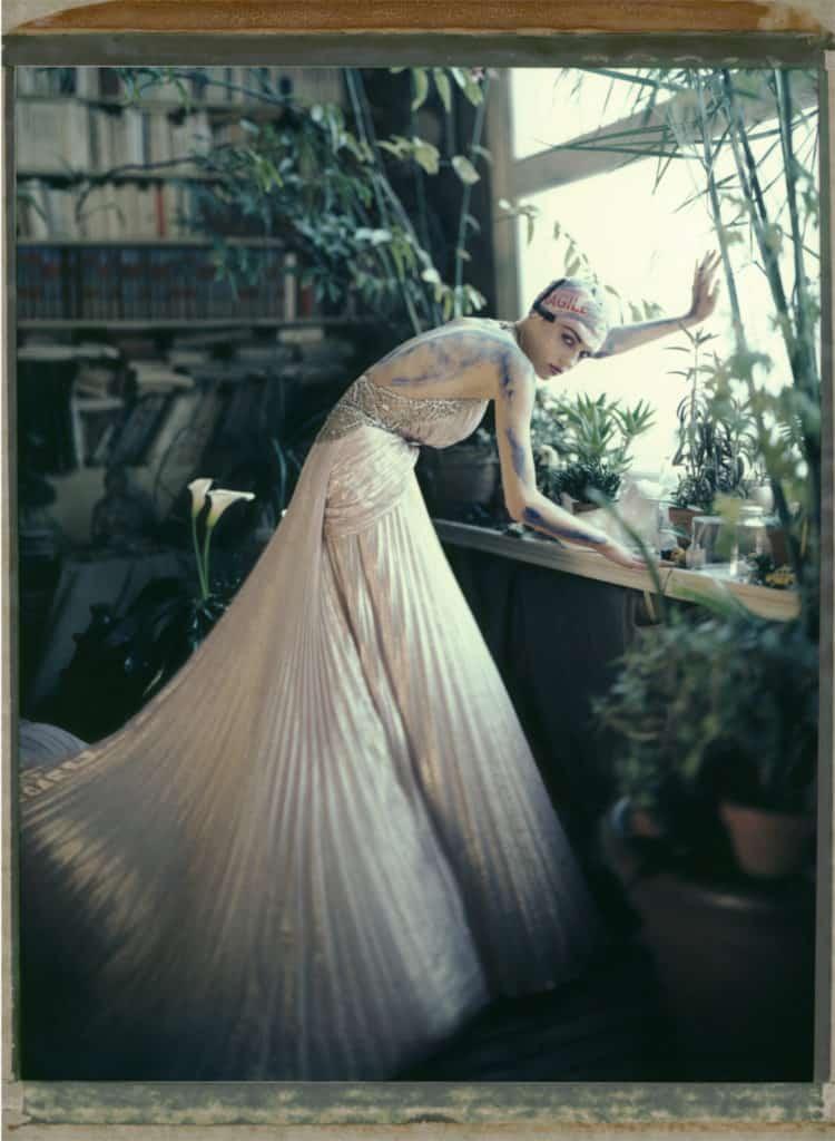 Fine art color photography of a fashion model wearing haute couture by Elie Saab, photography at a painter's studio, Montmartre, Paris.
