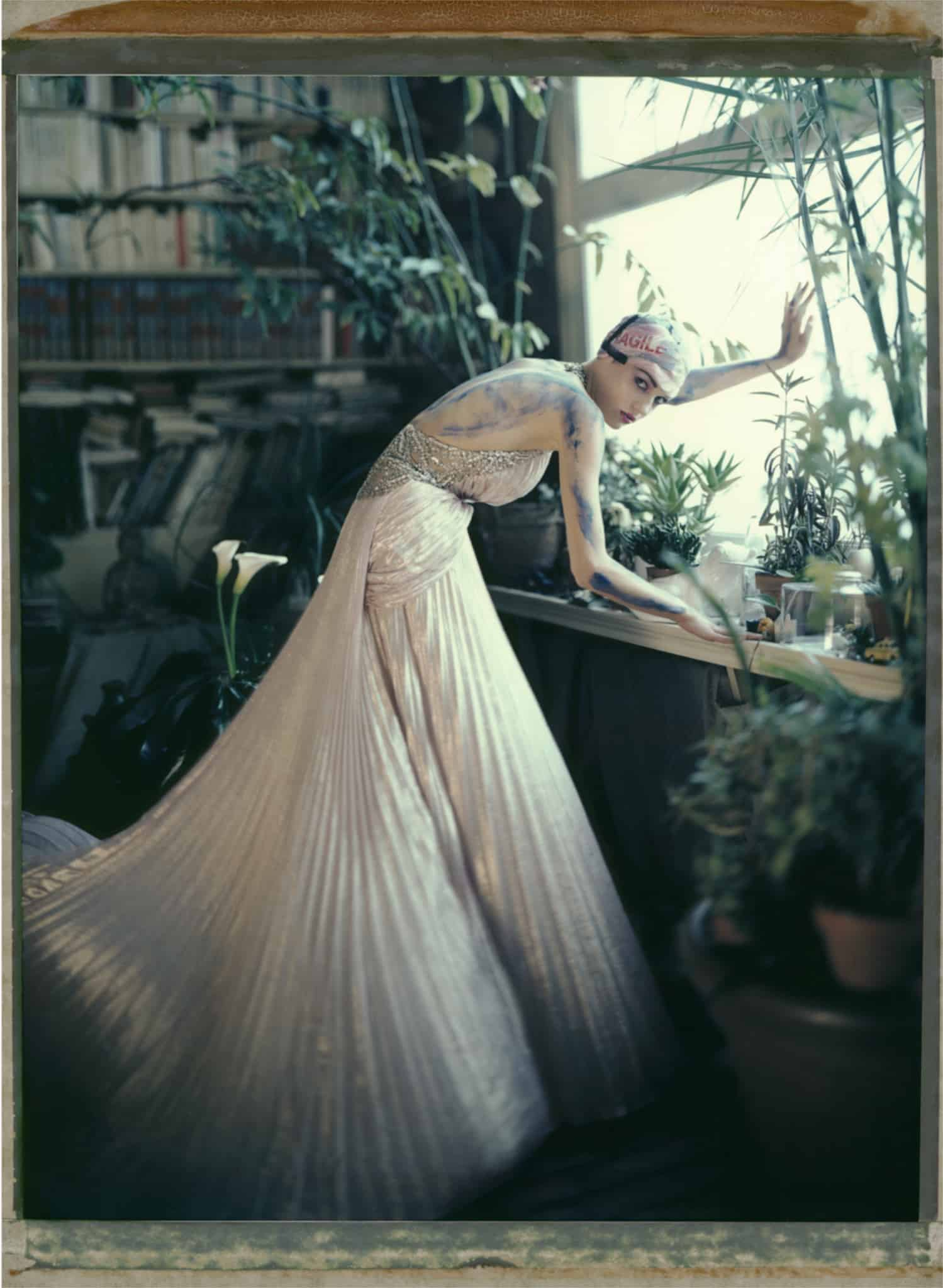 Fine art color photography of a fashion model wearing haute couture by Elie Saab, photography at a painter's studio, Montmartre, Paris.