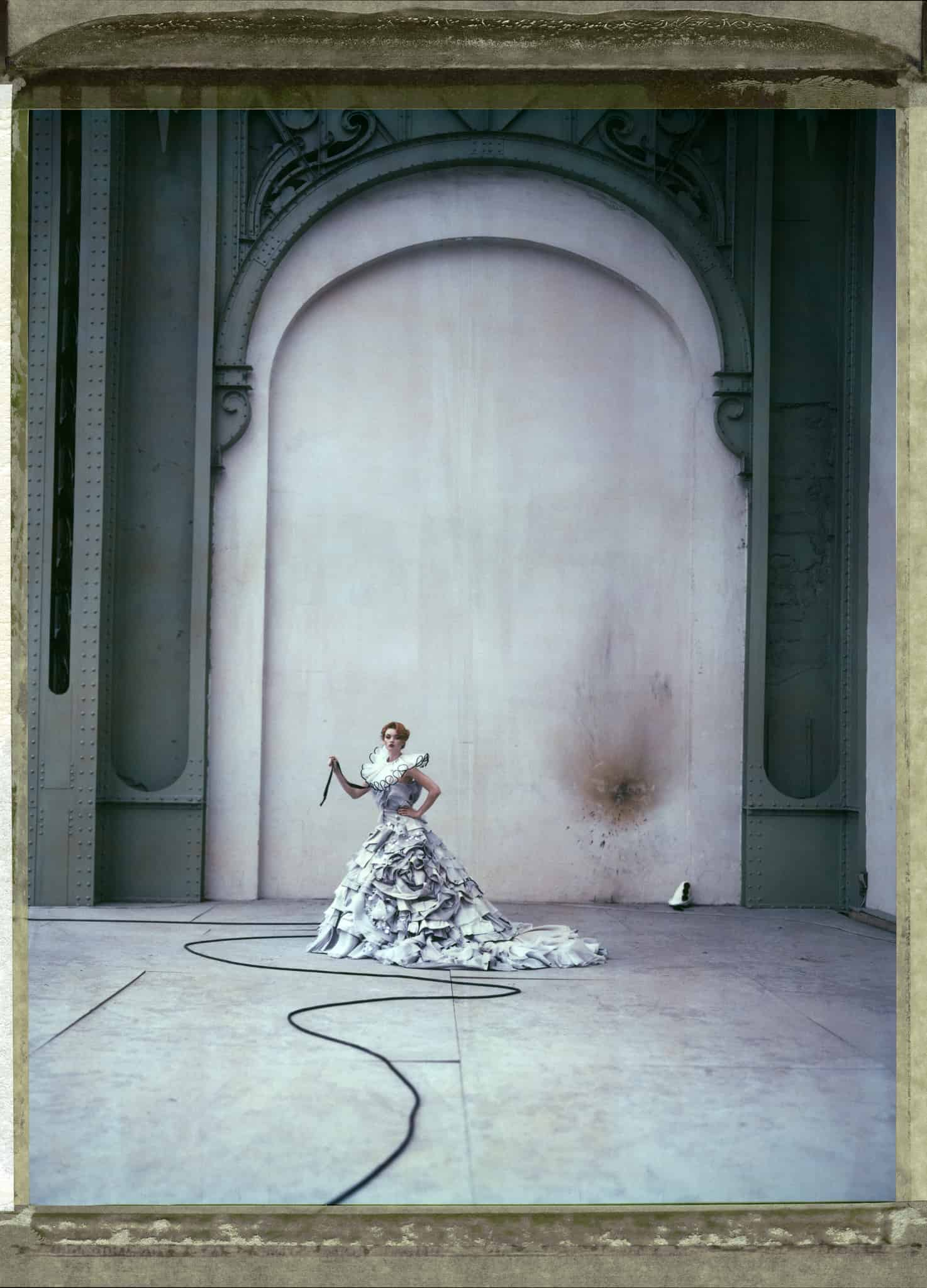Fine art color photography of fashion model wearing haute couture DIOR by John Galliano, at the Grand Palais, Paris.